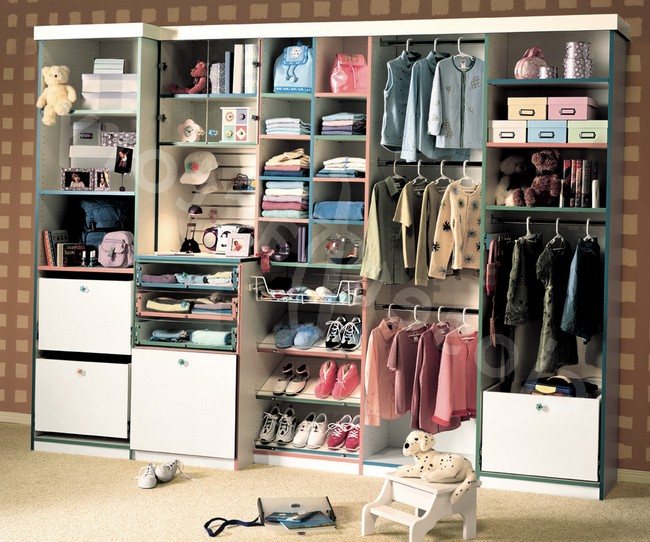 Highly organized closet surrounded by wallpaper in a neutral shade