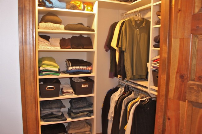 Closet For An Older Boy In Neutral Colored Shades Creating A Calm And