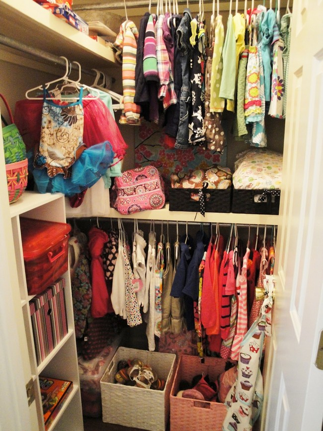 Colorful clothes hanging in this closet help set a cheerful mood