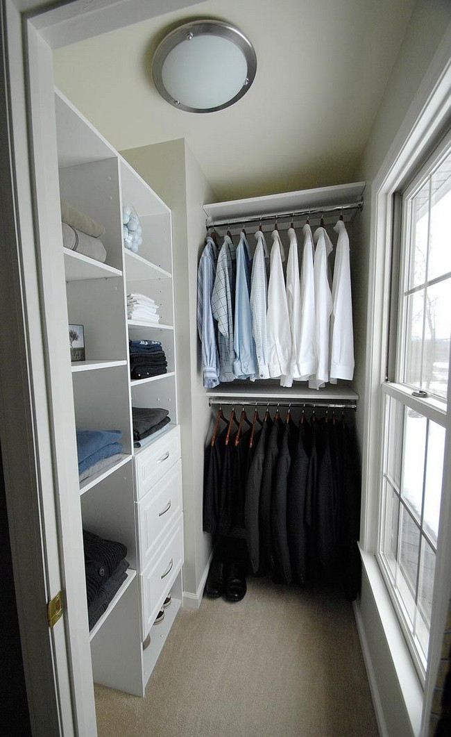 White closet that gets even brighter with the natural light coming in through the window