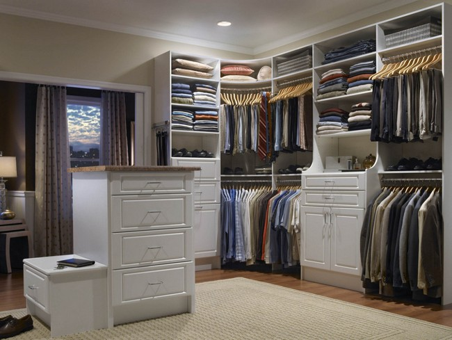 : Neatly organized men's closet with different sections for different items, creating order and making it easy to find items