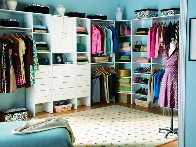 Bright women's closet with blue walls and colorful rug