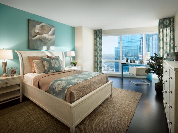 Use Of Blue Adds Charm To This Tan Bedroom