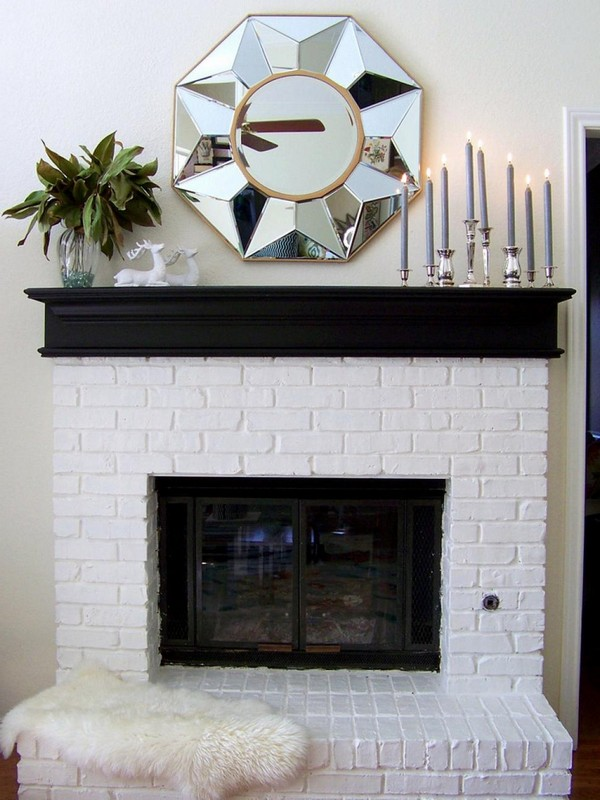 Elegant shiny mirror on fireplace mantel