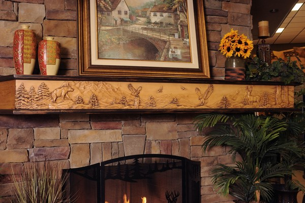 Combination of a variety of different décor pieces on fireplace mantel