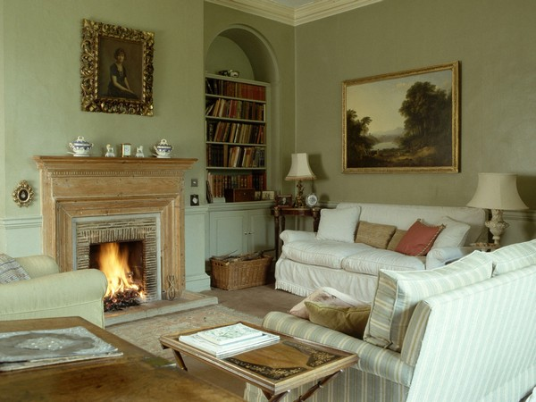 Painting in vintage frame above fireplace mantel