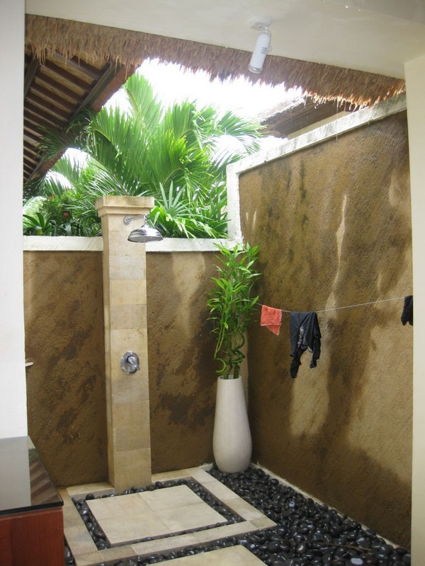 Open shower surrounded by garden