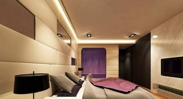 Circular Wooden Pieces Of Different Sizes Have Been Stacked Against The Wall,  While The Lighting And Yellow And Purple Pieces Help Break The Monotony Of  The ...