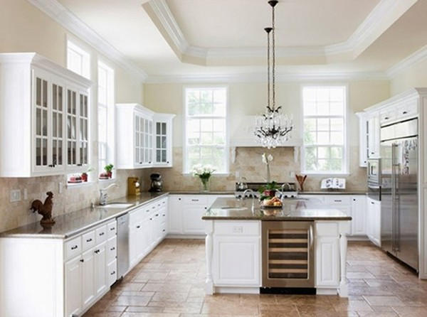 Brown stone floor, countertops and backsplash create a beautiful contrast