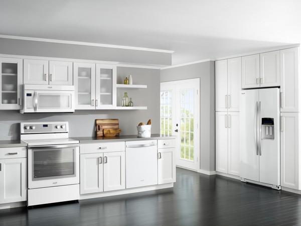 White spacious kitchen with dark grey hardwood floor