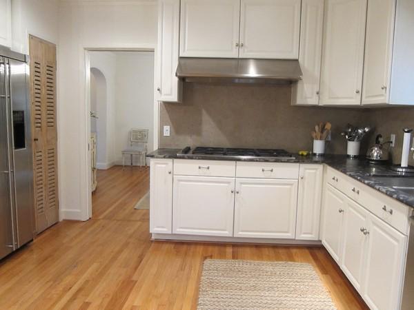 White kitchen with dark grey fridge and countertops