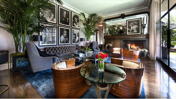 Personalized living room with a black and white framed photo gallery