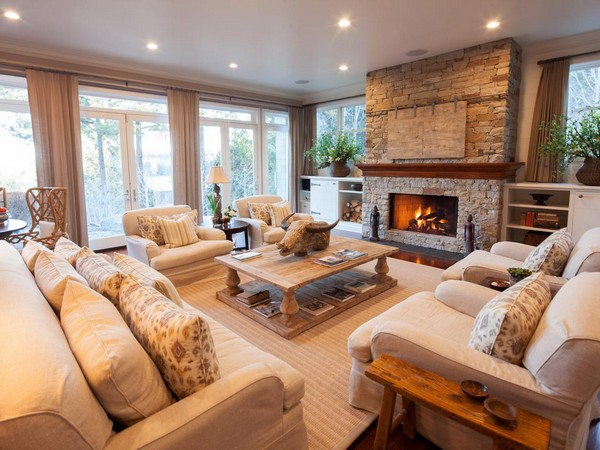 Spacious family room with stone fireplace that breathes warmth and comfort into the room