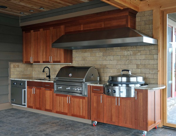 Outdoor kitchen creativity what to do with that extra for Building outdoor kitchen cabinets