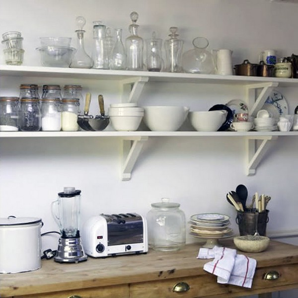 an open shelving design especially when painted in light colors like white or bold colors like grey help open up the space visually as seen here - Open Shelves Kitchen Design Ideas