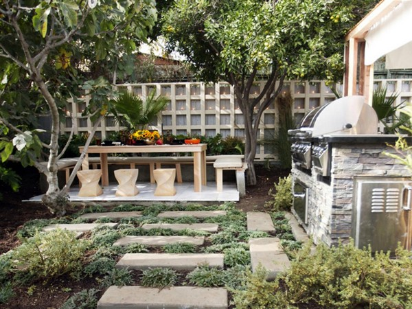 Outdoor kitchen with trees, shrubs and flowers