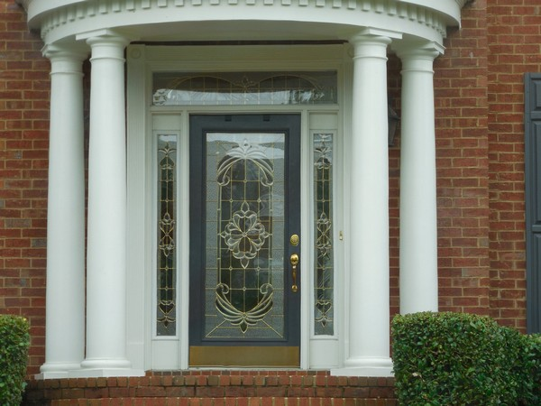 Frosted glass door with inscribed art